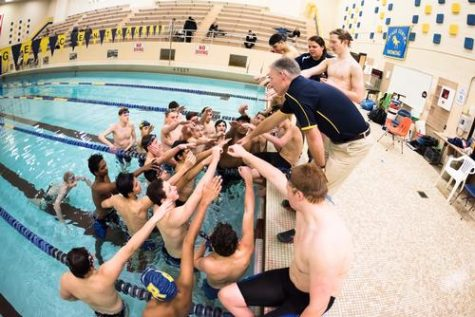Men's swimming team finishes out the season with a bang