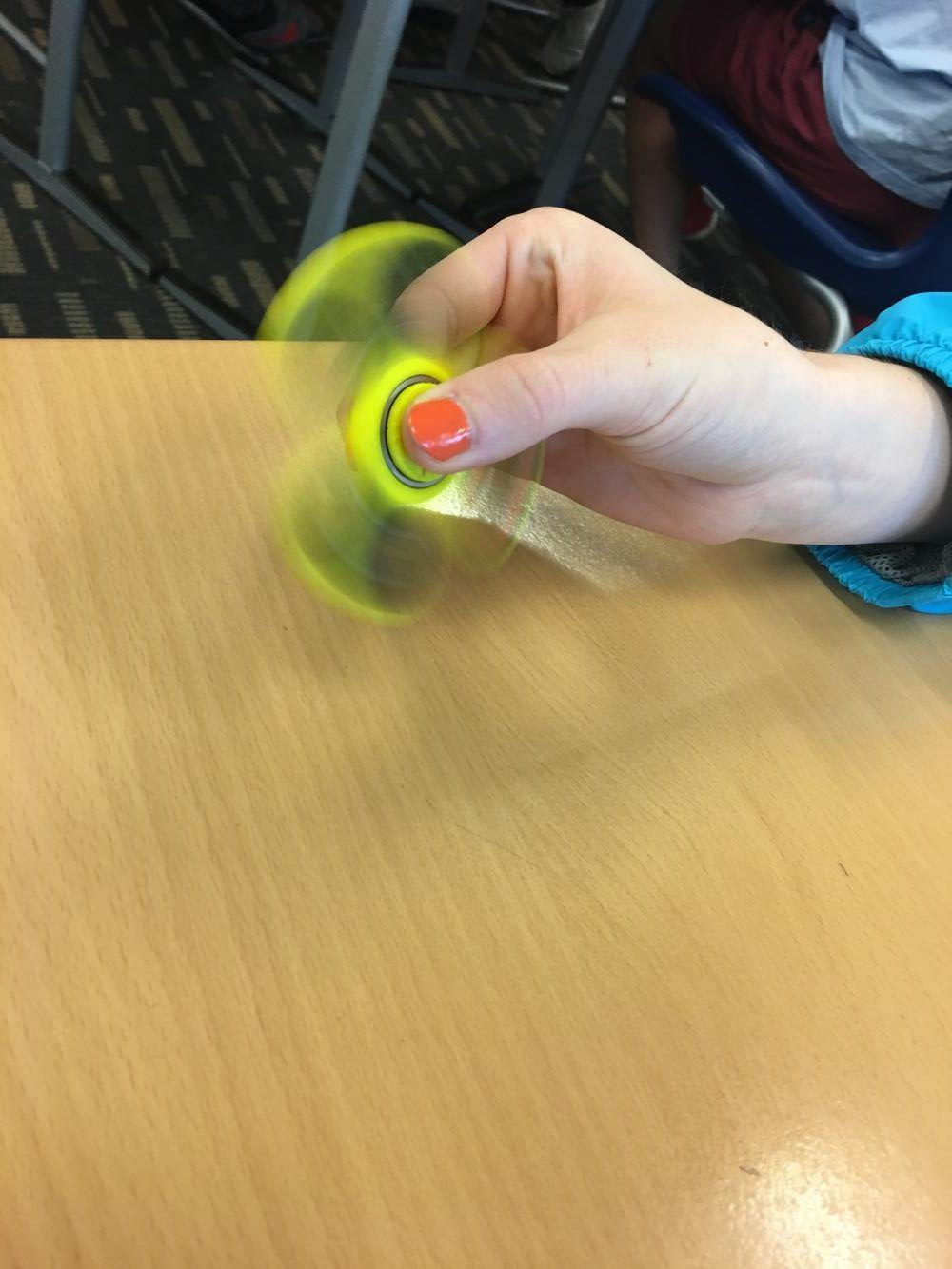 Student spins her fidget spinner to increase their classroom production