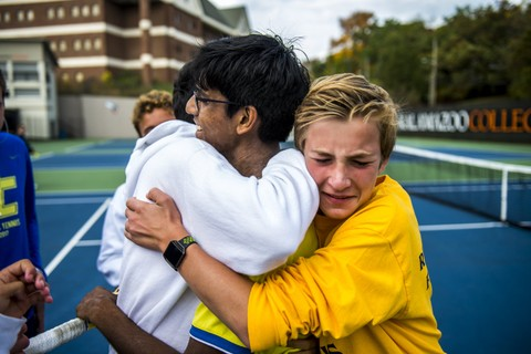 Senior Vishnu Ghantasala is caught in a fierce embrace with his team mates, after the conclusion of their final tennis match.