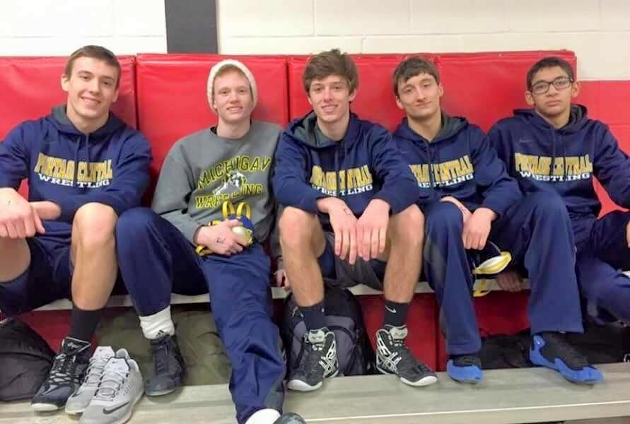 Roman Zwierzchowski (middle) pictured with Dante Latora (second from left) and the wrestling team.