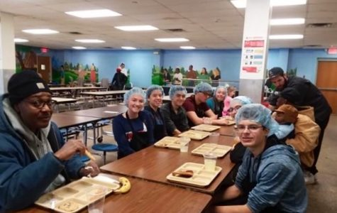 Students led by English teacher James Phillips make effort to help those in need at the Kalamazoo Gospel Mission