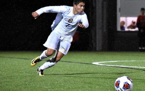 Senior Minh Le exhibits excellent skill during the men's soccer team's final game of the season.