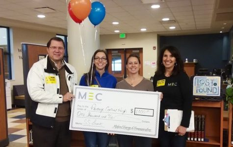 School librarian Sara Brown receives $1K from Midwest Energy & Communications in aid for CommuniTeen Read program