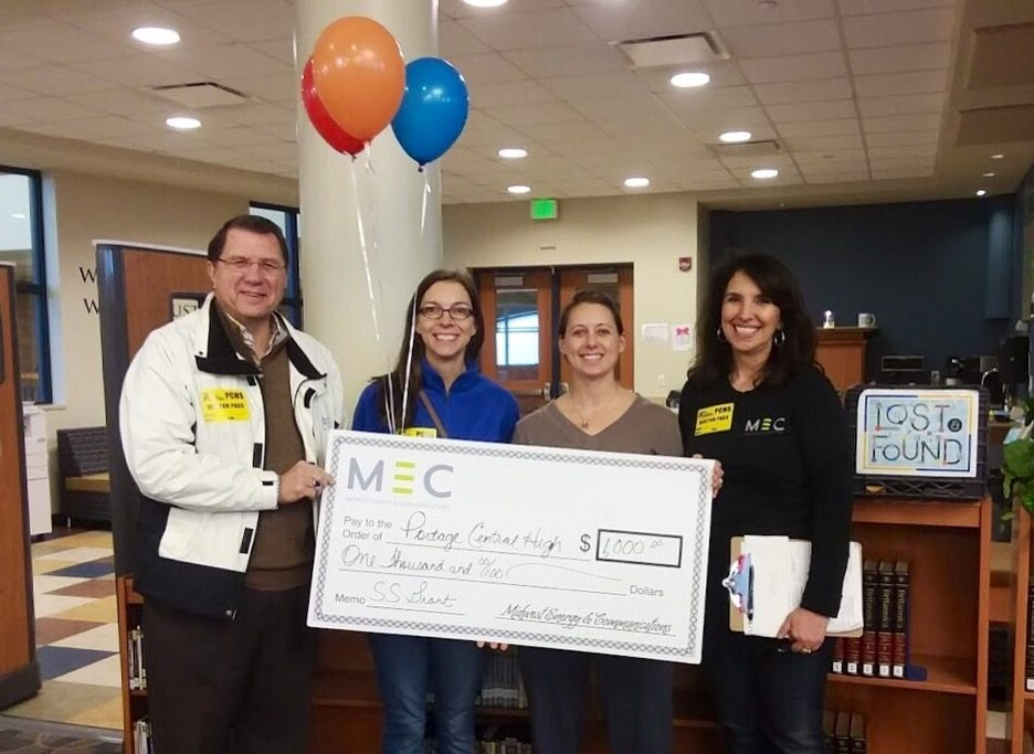 School librarian Sara Brown received a $1000 check from Midwest Energy  Communications on behalf of the school to further the PC reading program on Jan. 10.