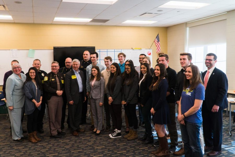 Representative Upton, teachers, community law enforcement, and students from Democrats Club, Republican Club, Student Council, and Central Stampede pose for a group picture after their one-hour discussion.