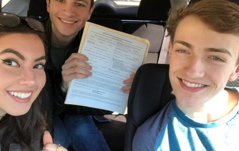 From left. seniors and PC Democrat's Club leaders Christina Cincilla, Ben Miller, and Mitchell Harpenau hold voter registration forms, encouraging students to get registered.